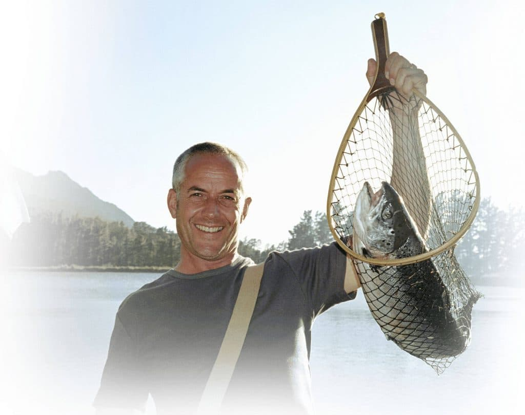 man holding fish in a net